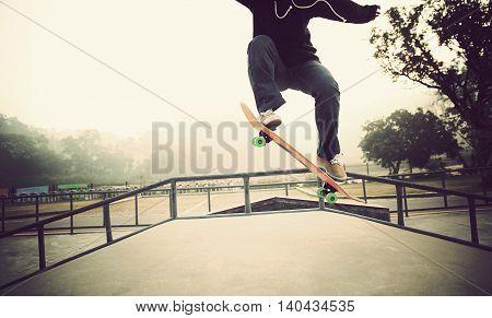 one young woman skateboarder skateboarding at skatepark