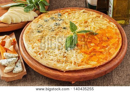 Pizza with blue cheese, parmesan, emmental and mozarella