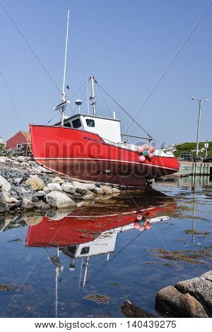 Old fishing boad has run aground on the rocks