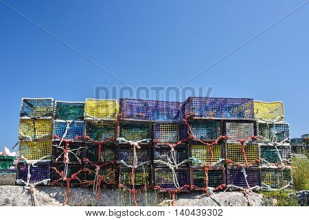 Colorful nets and ropes of stacked lobster traps