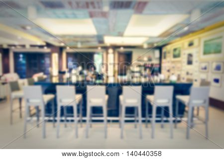Abstract of blurred beverage bar with bartender background