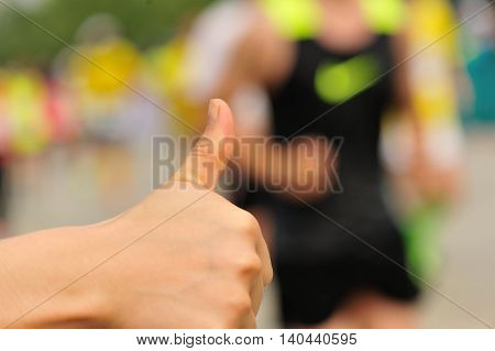 closuep of people thumb up for marathon runners