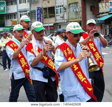 Playing A Chinese Wind Instrument