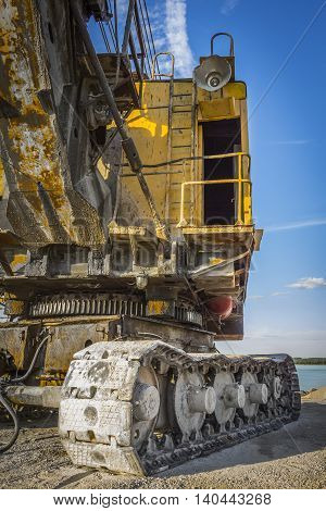 The cabin of the old yellow excavator