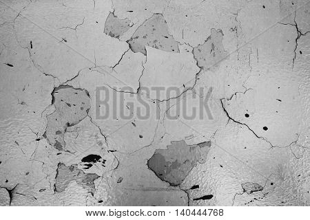 broken concrete walls with peeling paint texture.