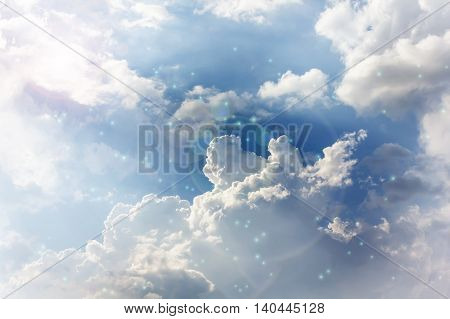 Romantic Blue Dreamy Puffy Clouds Sky With Lense Flare