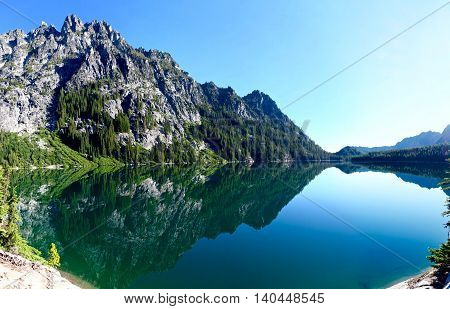 Reflection in alpine lake. Upper Snow Lake, Enchantment Lakes basin, Leavenworth, Seattle, Washington State, USA.