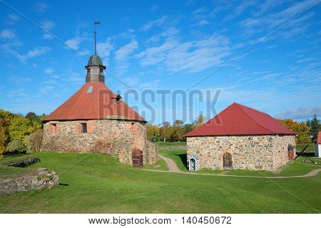 The building of the old Arsenal and the Round tower of the fortress Korela. Priozersk, Leningrad region, Russia poster