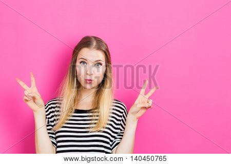 Young Woman Giving The Peace Sign