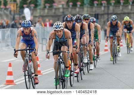 STOCKHOLM SWEDEN - JUL 02 2016: Group of colorful male triathlete cyclists Jelle Geens (BEL) and competitors in the Men's ITU World Triathlon series event July 02 2016 in Stockholm Sweden