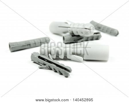 Gray dowels, isolated on white background with copy space