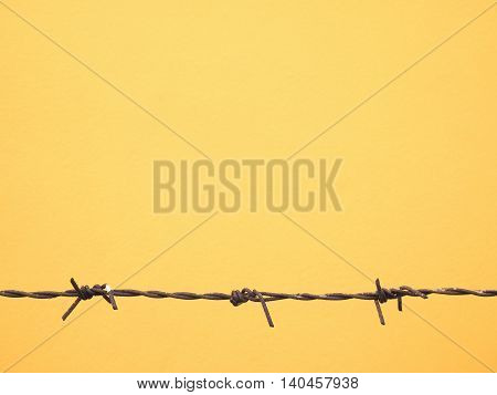 Bared wire silhouette for yellow background. Texture