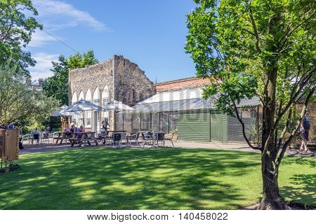Bury St Edmunds/UK. 18th July 2016. Day tourists having refreshments at a cafe as part of the Abbey Gardens estate in Bury St Edmunds.