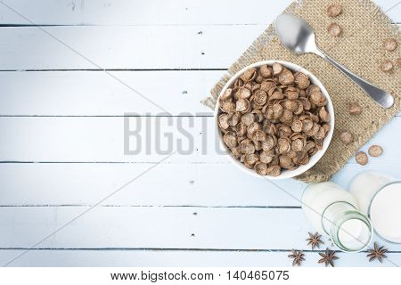Cereal food and milk bottle and milk glass  on wooden sky blue table.Meal or breakfast hi-vitamin and calcium.2