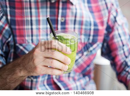 young man holding refreshing lemonade. Hot summer.