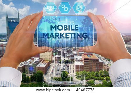 The Girl Looks At A Virtual Screen Of Your Smartphone And See The Inscription : Mobile Marketing