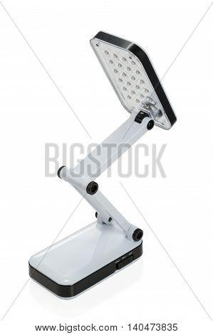 Small foldable LED luminaire isolated on white background