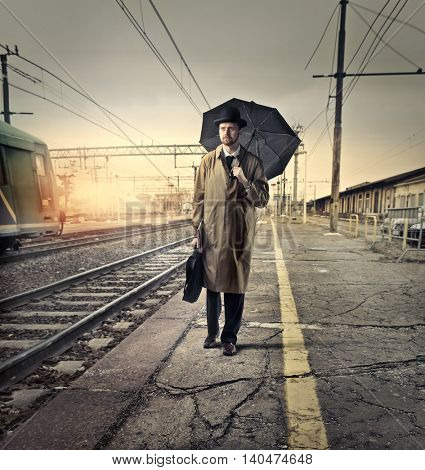 English businessman waiting at the train station