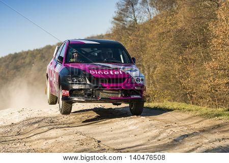 Lviv Ukraine - November 1 2015: Anton Korzun's Mitsubishi Lancer Evo IIIV (No.15) competes at the annual Rally Galicia