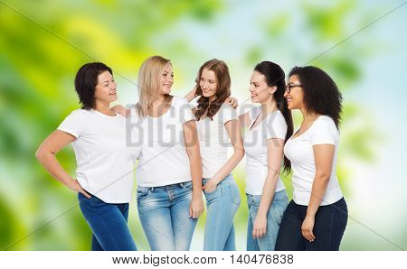 friendship, diverse, body positive and people concept - group of happy different size women in white t-shirts hugging over green natural background