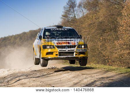 Lviv Ukraine - November 1 2015: Petrenko Volodymyr's Mitsubishi Lancer Evo IX (No. 2) competes at the annual Rally Galicia