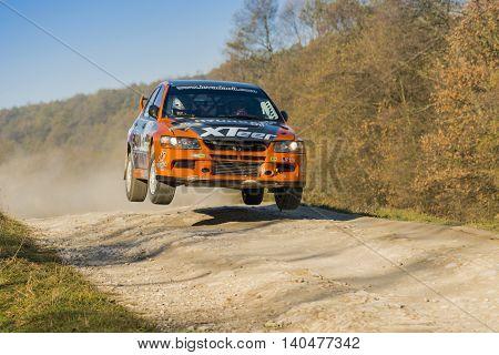 Lviv Ukraine - November 1 2015: Ivan Ostapchenko's Mitsubishi Lancer Evo VII (No. 11) competes at the annual Rally Galicia
