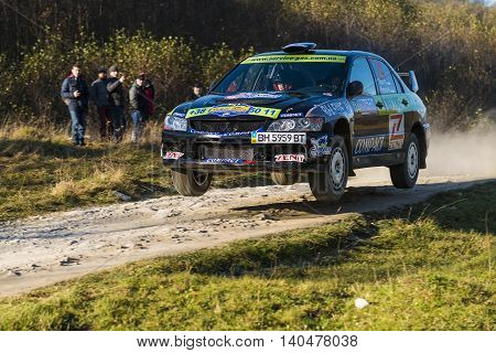 Lviv Ukraine - November 1 2015: Ruslan Topor's Mitsubishi Lancer Evo IX (No.24) competes at the annual Rally Galicia