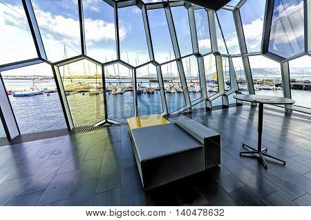 Reykjavik, Iceland - August 08, 2012: View Old harbor as seen from Harpa concert Hall interior. Harpa is a concert hall and conference center in Reykjavik opened on May 4, 2011.