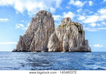 The faraglioni of Capri Island, Italy. Faraglioni are stacks, a coastal rock formation eroded by waves. They are found at the coasts of several regions and the most famous are off the island of Capri.