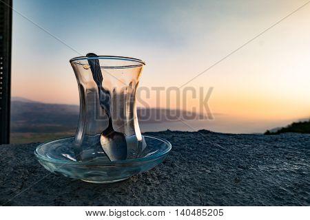 Empty turksih traditional tea glass on a wonderful scenary