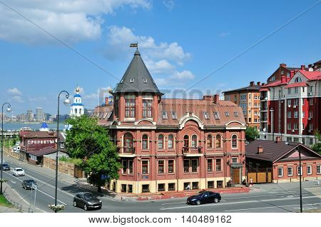 Kazan, Tatarstan, Russia - July 29, 2016. Crossroads Street Baturin and Karl Marx Street, a beautiful corner house at number 1. The stylized inscription on a small two-story building