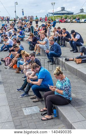 Amsterdam the Netherlands - July 13 2016: Pokémon GO hot spot at Kijkduin The Hague the Netherlands