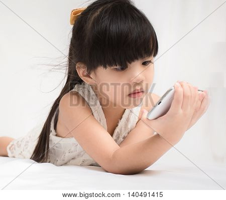 Children play Smart Phone on white background