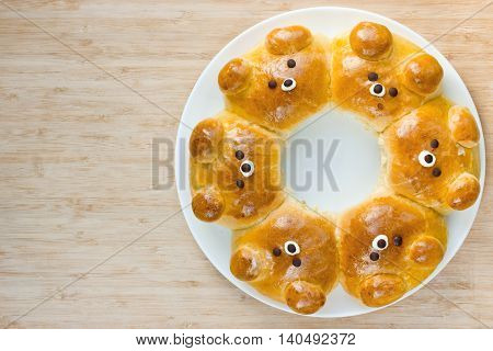 Bear buns. Ridiculously adorable pull-apart bear shaped milk bread rolls. Cute and kawaii Japanese style food art. Creative idea for food art for kids top view blank space for text