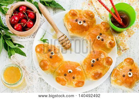 Bear buns. Ridiculously adorable pull-apart bear shaped milk bread rolls. Cute and kawaii Japanese style food art. Creative idea for food art for kids top view poster