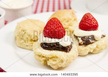a traditional Cornish cream tea with a cup of tea