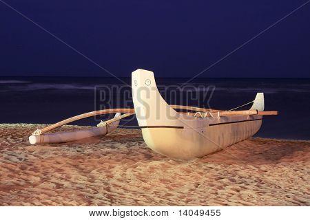 Outrigger canoe on beach
