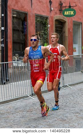 STOCKHOLM - JUL 02 2016: Running triathletes Fernando Alarza (ESP) and Andreas Schilling (DEN) in the old town of Stockholm in the Men's ITU World Triathlon series event July 02 2016 in Stockholm Sweden