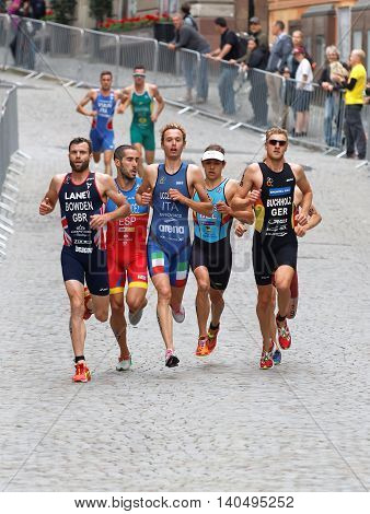 STOCKHOLM - JUL 02 2016: Running triathletes in the old town of Stockholm in the Men's ITU World Triathlon series event July 02 2016 in Stockholm Sweden