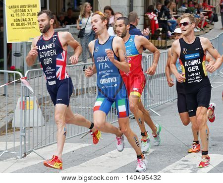 STOCKHOLM - JUL 02 2016: Side view of running triathletes in a curve in the Men's ITU World Triathlon series event July 02 2016 in Stockholm Sweden