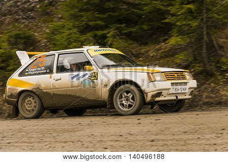 Lviv Ukraine - March 13 2016: Unknown racer on the car brand ZAZ (No.25) overcome the track at the annual Rally of Winter peaks near the city of Nyzni Worota Ukraine