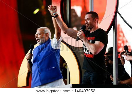 NEW YORK-SEPT 27: Prime Minister of India Narendra Modi (L) & Hugh Jackman speak at the 2014 Global Citizen Festival to end poverty by 2030 in Central Park on September 27, 2014 in New York City.