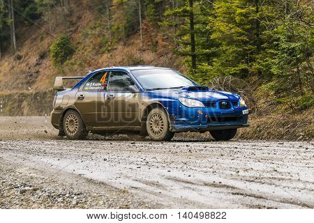 Nyzni Worota Ukraine - March 13 2016: Unknown racer on the car brand Subaru Impreza WRX (No.4) overcome the track at the annual Rally of Winter peaks near the city of Nyzni Worota Ukraine