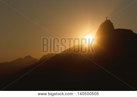 Sunset behind Mountain Corcovado Christ the Redeemer Rio de Janeiro Brazil. Selective focus. Toning effect