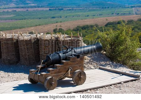 Historical artillery. Old cannon is fighting in a mountain area