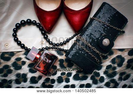 Women's set of fashion accessories. shoes, perfume and handbag