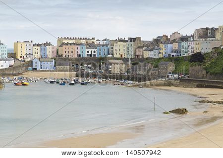 An image of the colorful Tenby Harbor shot at Tenby, Penbrokeshire, South Wales, UK