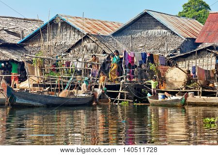 SIEM REAP, CAMBODIA-NOVEMBER 17, 2011: people of village on the water of Tonlesap lake. Cambodia