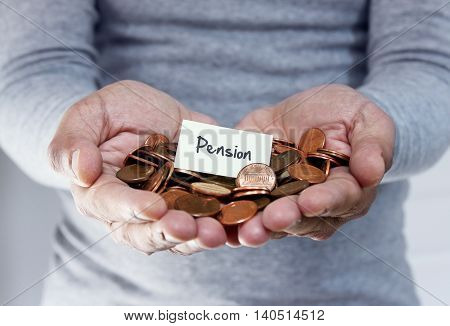 Man holding coins in hand for pension plan