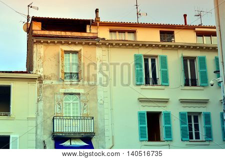 windows with traditional old french facade in antibes